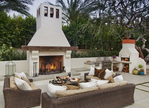 Burntech Outdoor Fireplace including couches and over area.