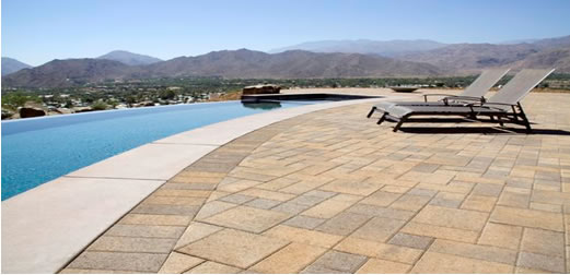 Acker Stone paver deck next to pool.