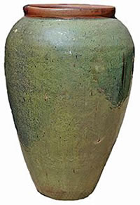 A tall green jar with a brown rim