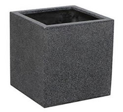 A large cube shaped pot made of terrazzo