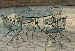 lightweight see-through small tabel and chairs on concrete patio pavers
