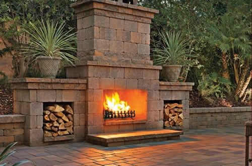 Large Outdoor Ventless Fireplace all masonry and side fire log places.