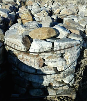 A bunch of light tan and grey boulders with rounded shapes
