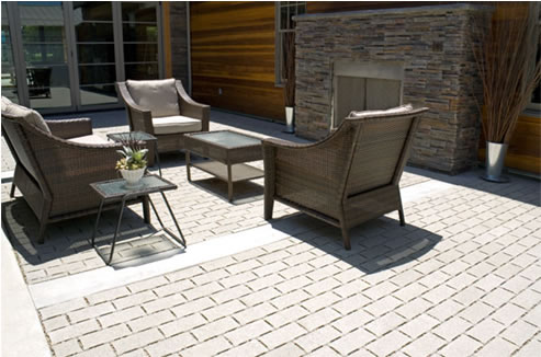 Outdoor Permeable pavers deck and chairs and table