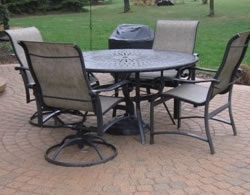 brick paver patio with chairs and table