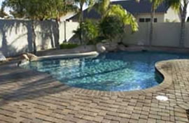 Native Blend thin veneer pavers shown surrounding a beautiful pool.
