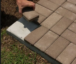 Installing thin pavers over concrete.